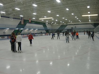 Kids ice skating.