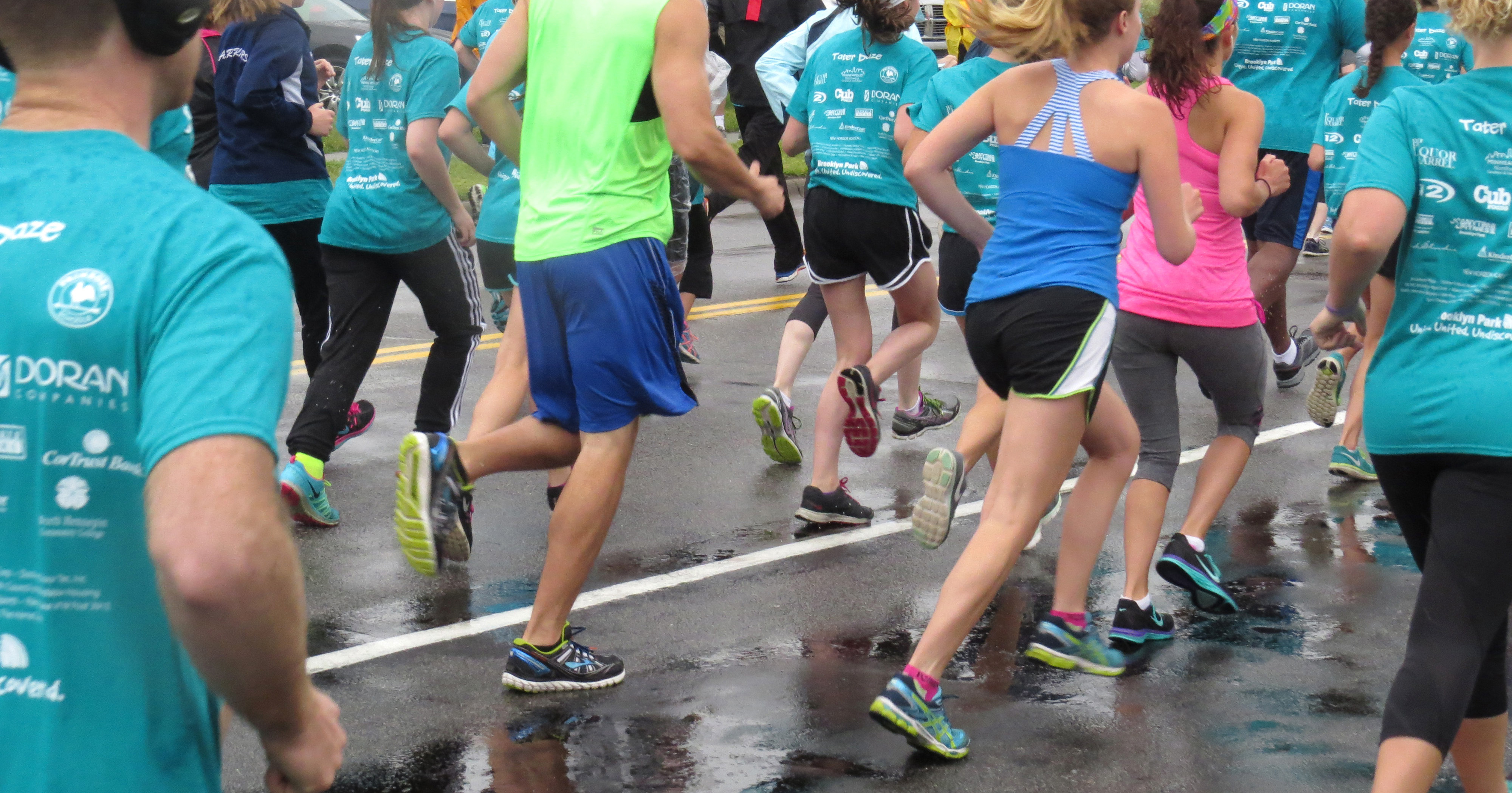 Legs of people running in the annual spud run.