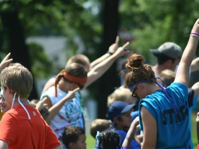 camp counselors having fun at camp