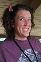camp director jen is smiling
