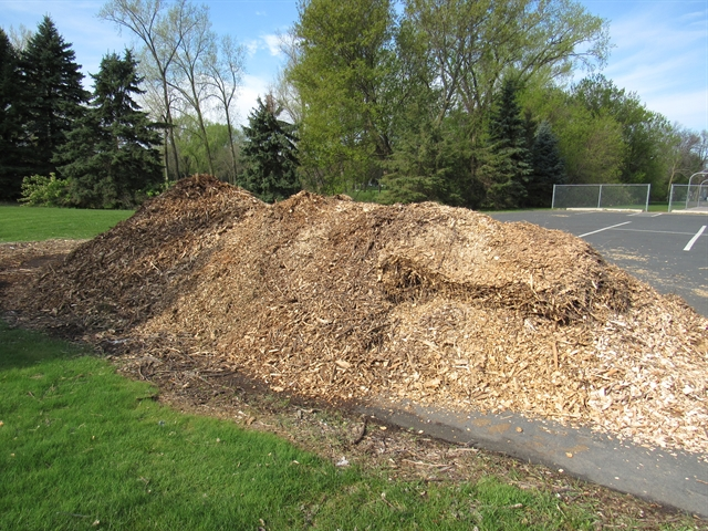 Pile of yard waste turned into wood mulch
