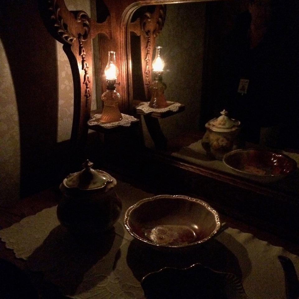 Dark room with candle burning
