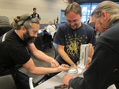 Men fixing a blender