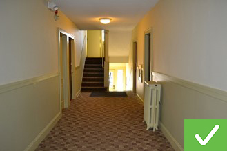 This hallway is clean, well-lit and accessible.