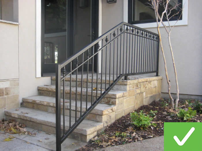 This four-step exterior stairway includes a guardrail.